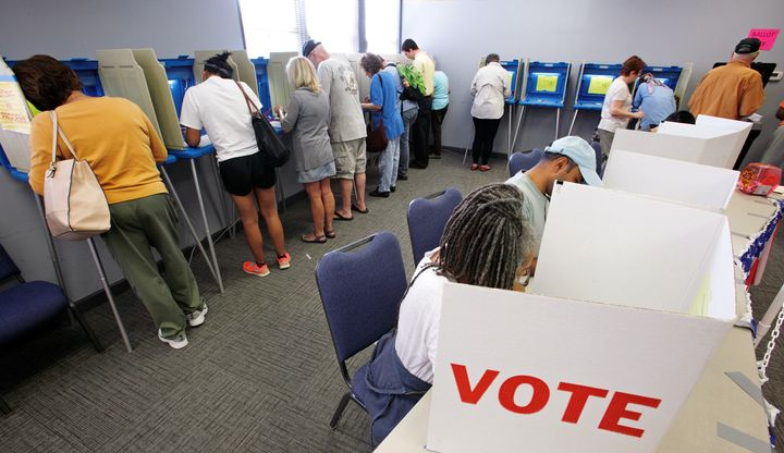 People cast their ballots for the 2016 general elections at a crowded polling station as early voting begins in North Carolin