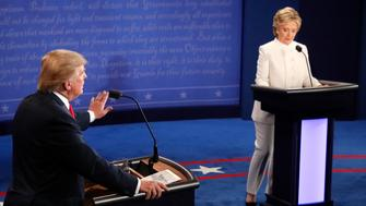 Republican nominee Donald Trump speaks as Democratic nominee Hillary Clinton looks on during the final presidential debate at the Thomas & Mack Center on the campus of the University of Las Vegas in Las Vegas, Nevada on October 19, 2016. / AFP / Mark  RALSTON        (Photo credit should read MARK  RALSTON/AFP/Getty Images)