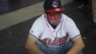 CLEVELAND, OH - NOVEMBER 03: A Cleveland Indians fan sits in the street after the Chicago Cubs defeated the Cleveland Indians in game 7 of the World Series in the early morning hours on November 3, 2016 in Cleveland, Ohio. The Cubs defeated the Indians 8-7 in 10 innings for their first World Series championship in 108 years. (Photo by Justin Merriman/Getty Images)