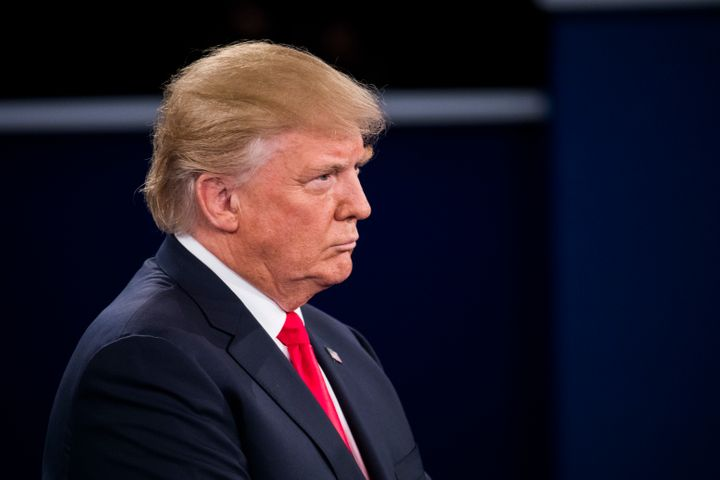 Republican presidential nominee Donald Trump listens during the town hall debate at Washington University on October 9, 2016