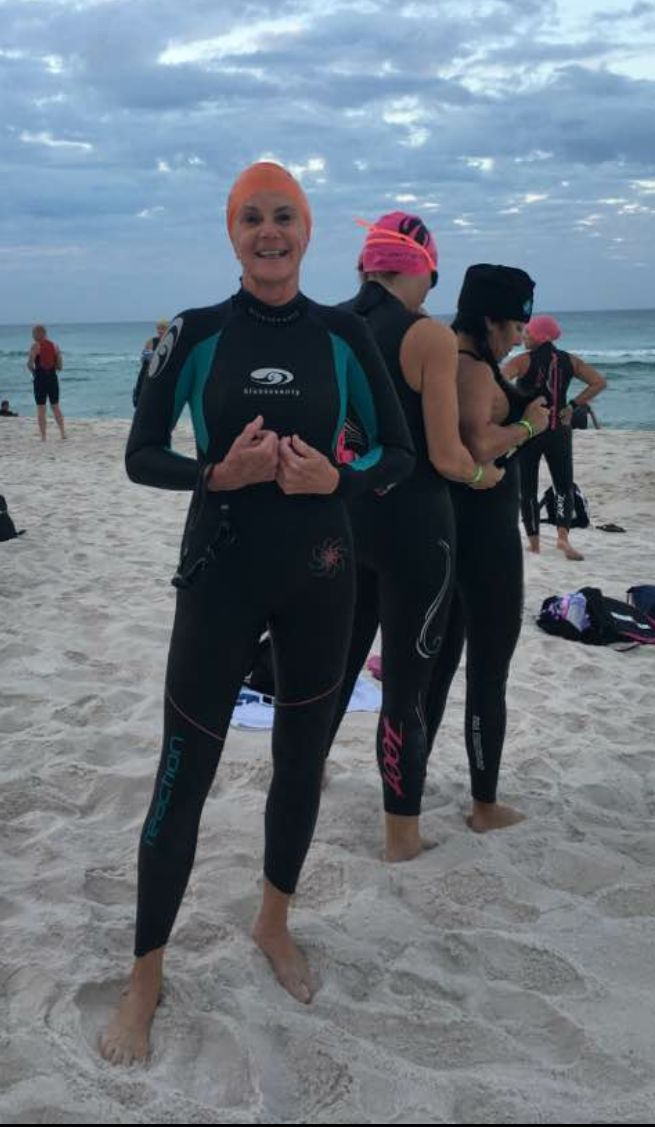 Gini Fellows, who's competing in IRONMAN Florida on November 5, 2016, on Panama City Beach getting ready for a practice swim
