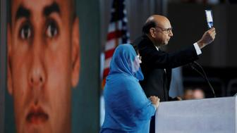 Khizr Khan, whose son Humayun (L) was killed serving in the U.S. Army, challenges Republican presidential nominee Donald Trump to read his copy of the U.S. Constitution, at the Democratic National Convention in Philadelphia, Pennsylvania, U.S. July 28, 2016.  REUTERS/Lucy Nicholson  TPX IMAGES OF THE DAY