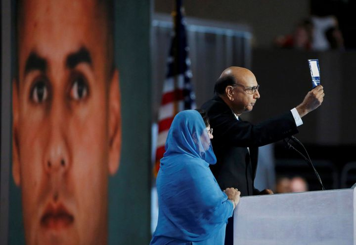 Khizr Khan, whose son Humayun (L) was killed serving in the U.S. Army, challenges Donald Trump to read his copy of the U.S. C