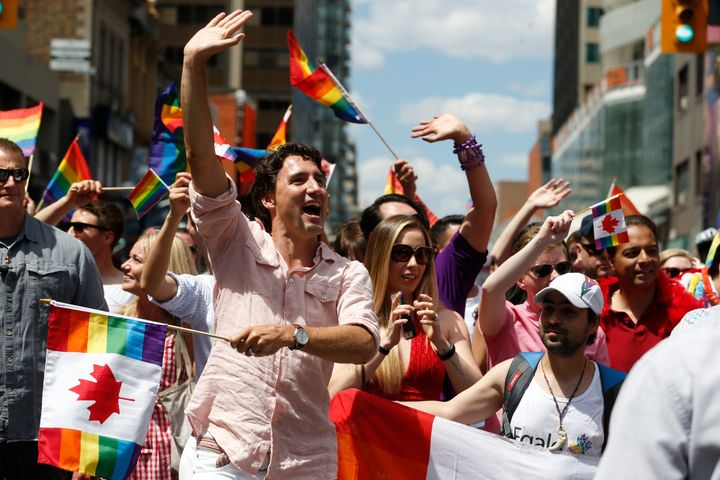 Trudeau attending Toronto's annual Pride Parade with Ontario's Kathleen Wynne, the first openly gay elected Premier in t