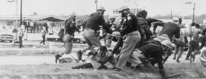 Rep. John Lewis (D-Ga.), then chairman of the Student Nonviolent Coordinating Committee, is beaten by police during&nbsp
