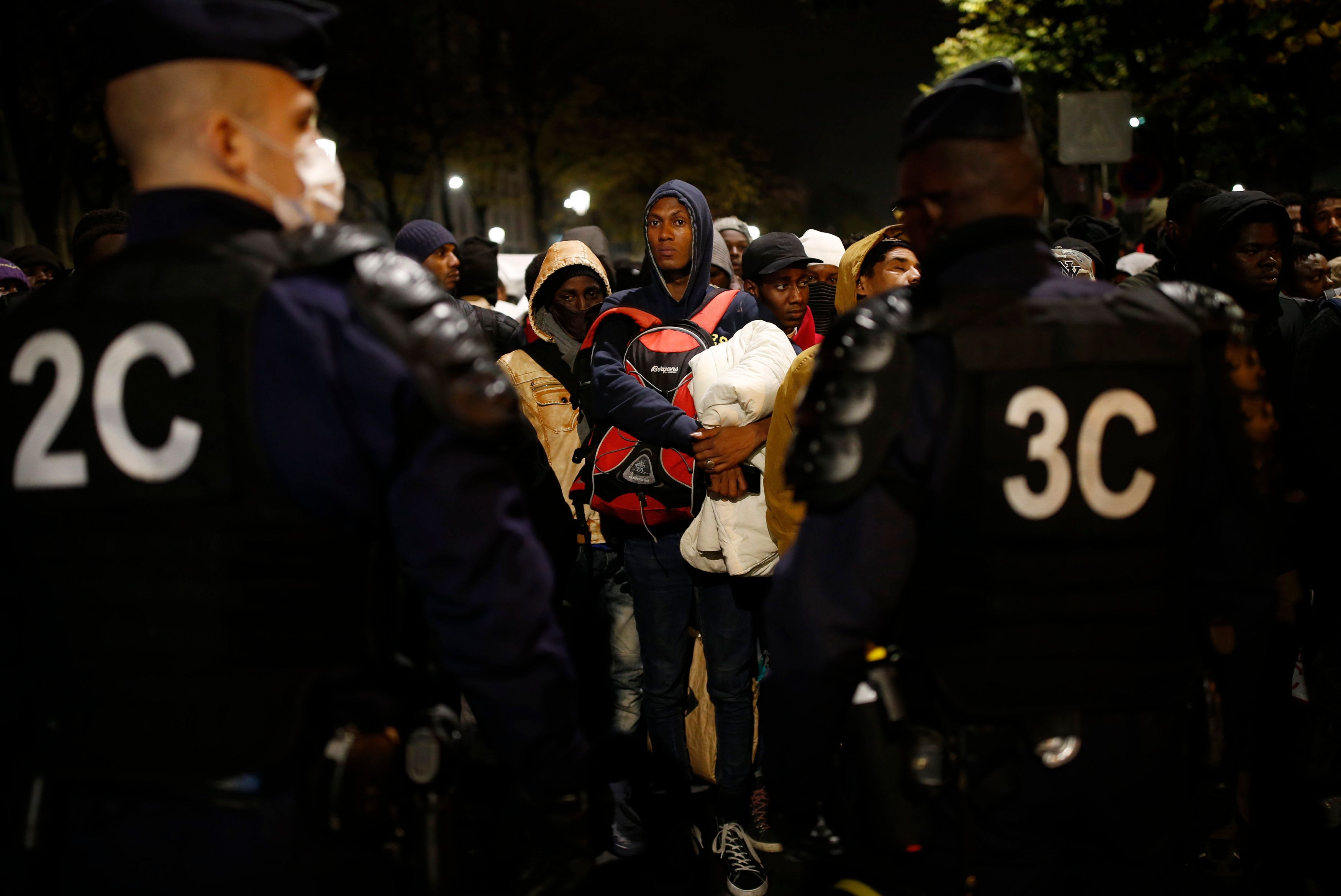 French policemoved in at daybreak, and escorted migrants to dozens of buses from the sprawl of tents and mattresses&nbs