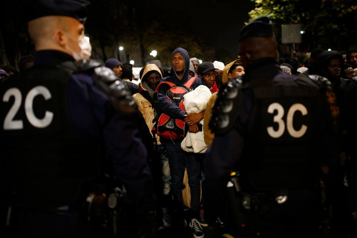 French police moved in at daybreak, and escorted migrants to dozens of buses from the sprawl of tents and mattresses&nbs