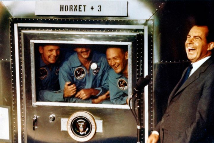 The Apollo XI astronauts Neil Armstrong, Michael Collins, and Buzz Aldrin with President Richard Nixon aboard the USS Hornet