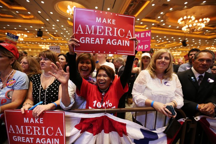 Supporters watch as Republican presidential nominee Donald Trump speaks during a campaign rally at the Venetian Hotel in Las