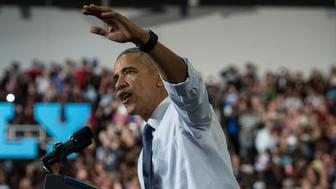 US President Barack Obama speaks at a rally for Democratic presidential candidate Hillary Clinton at the University of North Florida in Jacksonville, Florida, on November 3, 2016. / AFP / NICHOLAS KAMM        (Photo credit should read NICHOLAS KAMM/AFP/Getty Images)