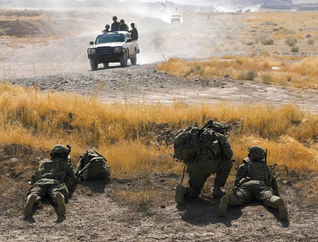 U.S. military advisers link up with Afghan security forces near Tarin Kowt, where there has been sustained...