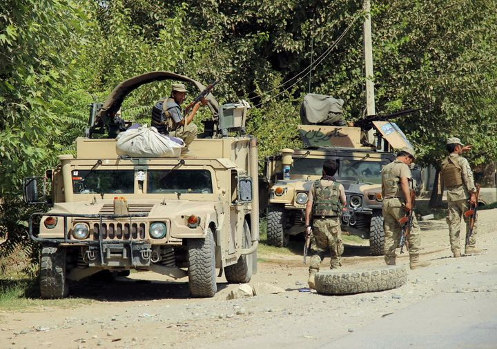 Afghan security forces prepare for battle on the outskirts of Kunduz in August.