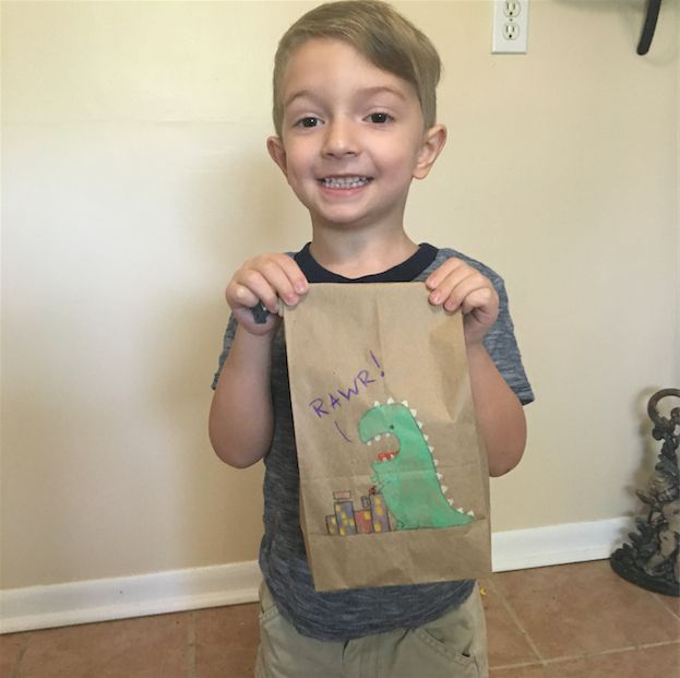 Huxley loves showing off his lunch bags to classmates and teachers.