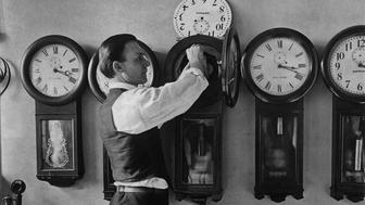 A man repairing one of the many clocks at the US Treasury in Washington D.C. circa 1930. (Photo by Keystone View/FPG/Getty Images)