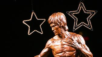 A statue of Hong Kong martial arts movie star Bruce Lee is unveiled, on Lee's 65th birthday, during a ceremony in Hong Kong November 27, 2005. The Bruce Lee Club organises a week-long Bruce Lee Festival from November 25 to December 1, 2005.