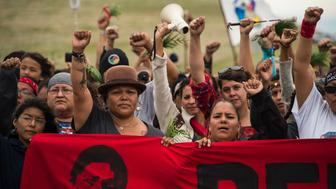 Native Americans march to a burial ground sacred site that was disturbed by bulldozers building the Dakota Access Pipeline (DAPL), near the encampment where hundreds of people have gathered to join the Standing Rock Sioux Tribe's protest of the oil pipeline that is slated to cross the Missouri River nearby, September 4, 2016 near Cannon Ball, North Dakota. / AFP / Robyn BECK / TO GO WITH AFP STORY by Nova SAFO, 'Native Americans united by oil pipeline fight'        (Photo credit should read ROBYN BECK/AFP/Getty Images)