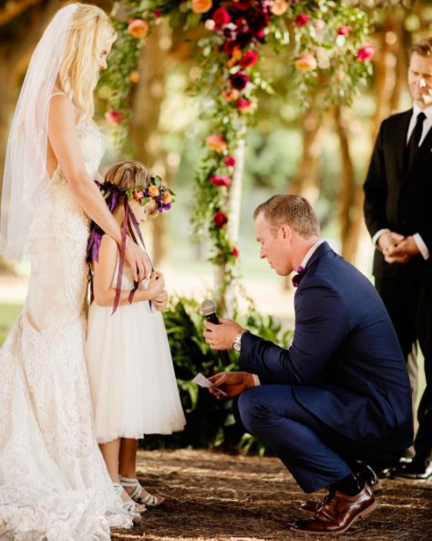 """It meant so much to me because he was not just marrying me, he was promising her the same things and it symbolized us all becoming one as a family,"" the bride said."
