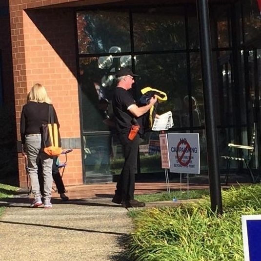 A man carrying a weapon outside of Loudoun County Registrars Office in Leesburg, Virginia.