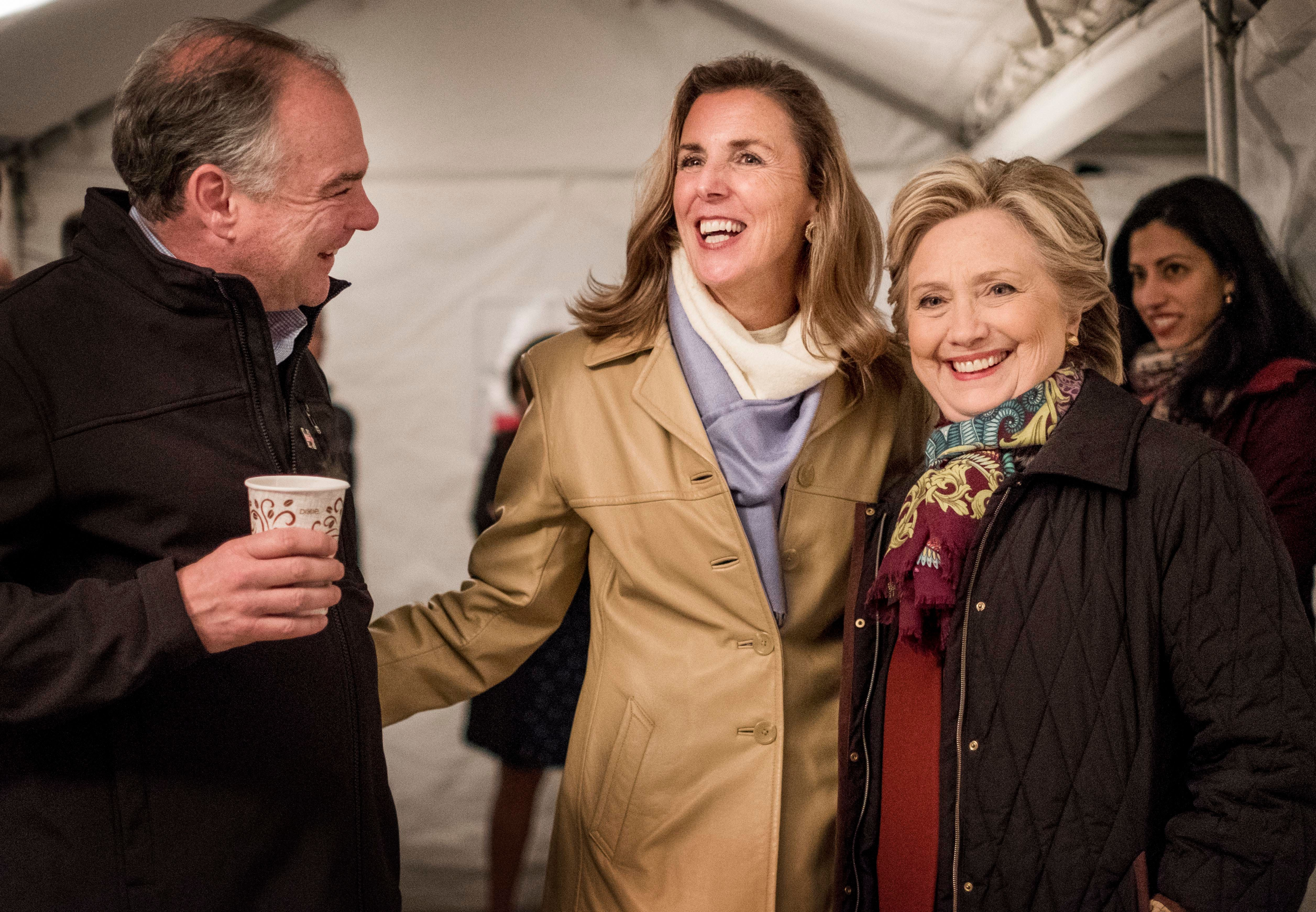 Katie McGinty, second from left, chats with Sen. Tim Kaine (D-Va.) and Democratic presidential nominee...