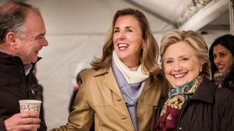 PHILADELPHIA, PA -  Democratic candidate for the US Senate Katie McGinty chats with Democratic Nominee for President of the United States former Secretary of State Hillary Clinton and Vice Presidential running mate Senator Tim Kaine before a rally at the Dunning-Cohen Champions Field Penn Park in Philadelphia, Pennsylvania on Saturday October 22, 2016. (Photo by Melina Mara/The Washington Post via Getty Images)