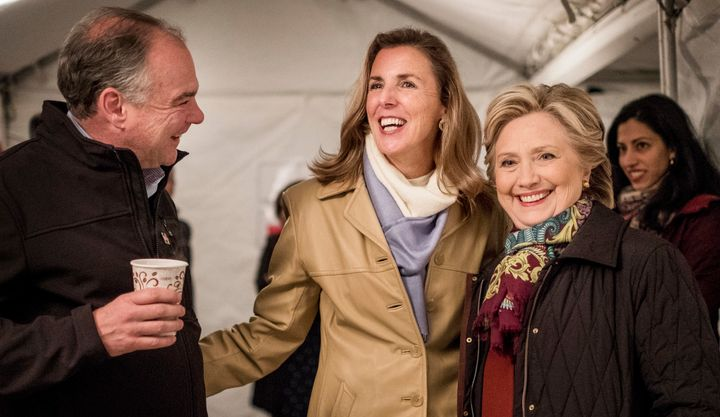 Katie McGinty, second from left, chats with Sen. Tim Kaine (D-Va.) and Democratic presidential nominee Hillary Clinton in Phi