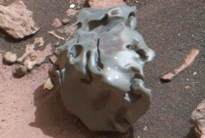 This close-up of the Martian meteorite discovered by the Curiosity rover shows several bright circular marks, the result of t