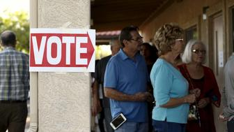 People wait to vote in the U.S. presidential primary election at a polling site in Glendale, Arizona March 22, 2016. REUTERS/Nancy Wiechec