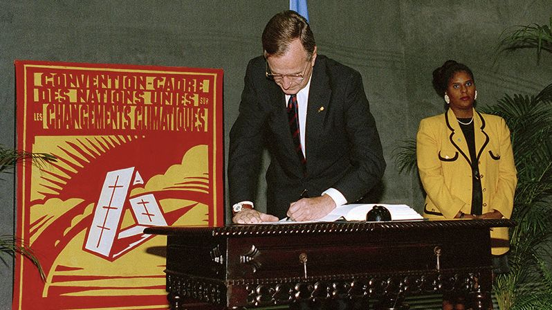 President George H. W. Bush signs the UN Framework Convention on Climate Change