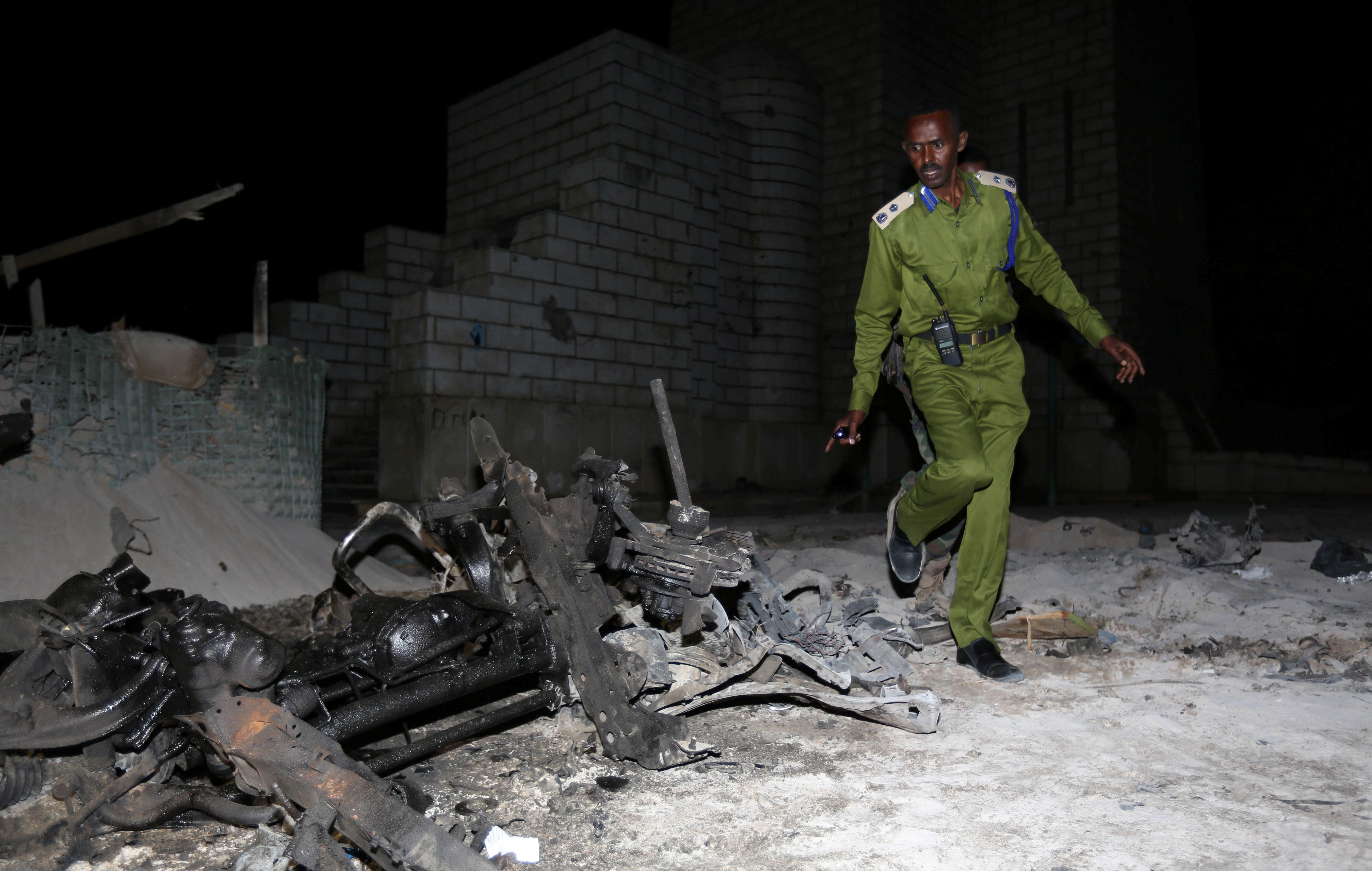 A Somali policeman inspects the scene of a suicide car explosion near the parliament in the capital Mogadishu, November 5, 2016. REUTERS/Feisal Omar     TPX IMAGES OF THE DAY