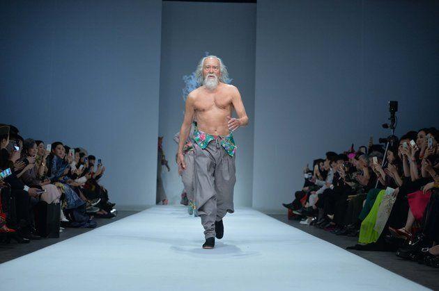 80 year-old model Wang Deshun struts a runway in 2015.