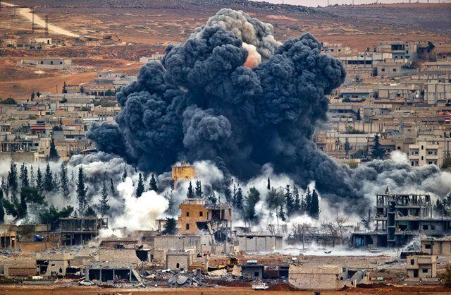 Smoke rises from the Syrian city of Kobani, following an airstrike by the U.S.-led coalition, seen from a hilltop outside Sur