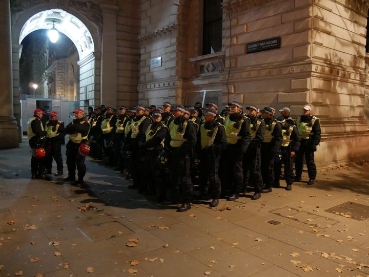 Police line up in front of the Cabinet War Rooms on Whitehall street amid fears of violence at the Million Mask March 2016.