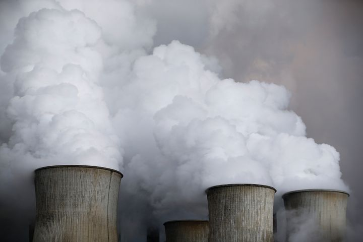 Steam from cooling towers of the coal power plant of RWE, one of Europe's biggest electricity and gas companies in Niederauss