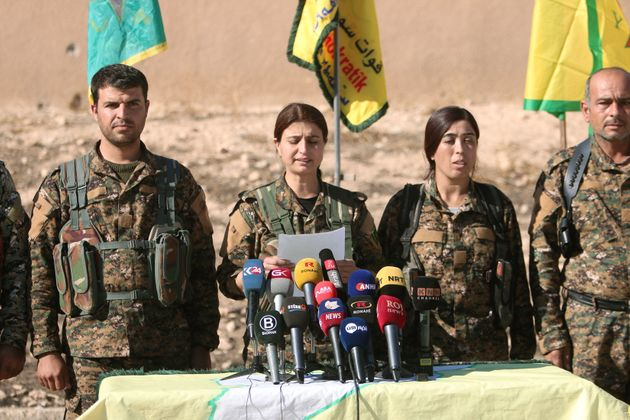 Syrian Democratic Forces (SDF) commanders attend a news conference in Ain Issa, Raqqa Governorate, Syria...