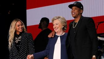 U.S. Democratic presidential nominee Hillary Clinton joins Jay Z and Beyonce onstage at a campaign concert in Cleveland, Ohio, U.S. November 4, 2016.  REUTERS/Brian Snyder