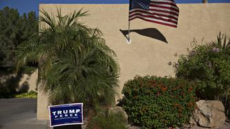 A campaign sign for Donald Trump, 2016 Republican presidential nominee, and Mike Pence, 2016 Republican vice presidential nominee, stands outside a home in Mesa, Arizona, U.S., on Wednesday, Nov. 2, 2016. Five days from the U.S. presidential election, polls released Thursday showed the race narrowing, with Democrat Hillary Clinton holding on to a slim lead over Trump. Photographer: Daniel Acker/Bloomberg via Getty Images