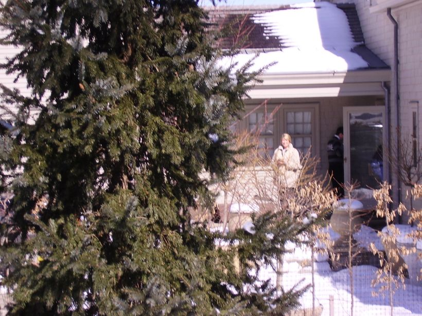 Martha Stewart under house arrest in front of her Bedford, New York, home in 2005.