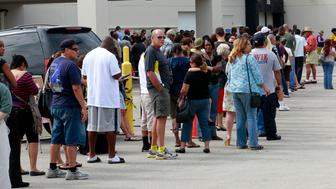 Long lines of voters are seen at the Supervisor of Elections office in West Palm Beach, Florida November 5, 2012. Palm Beach County Supervisor of Elections Supervisor Susan Bucher is one of five supervisors in heavily populated counties who has allowed in-person absentee voting after Florida Republican Governor Rick Scott refused to extend early voting. REUTERS/Joe Skipper  (UNITED STATES - Tags: POLITICS ELECTIONS USA PRESIDENTIAL ELECTION)