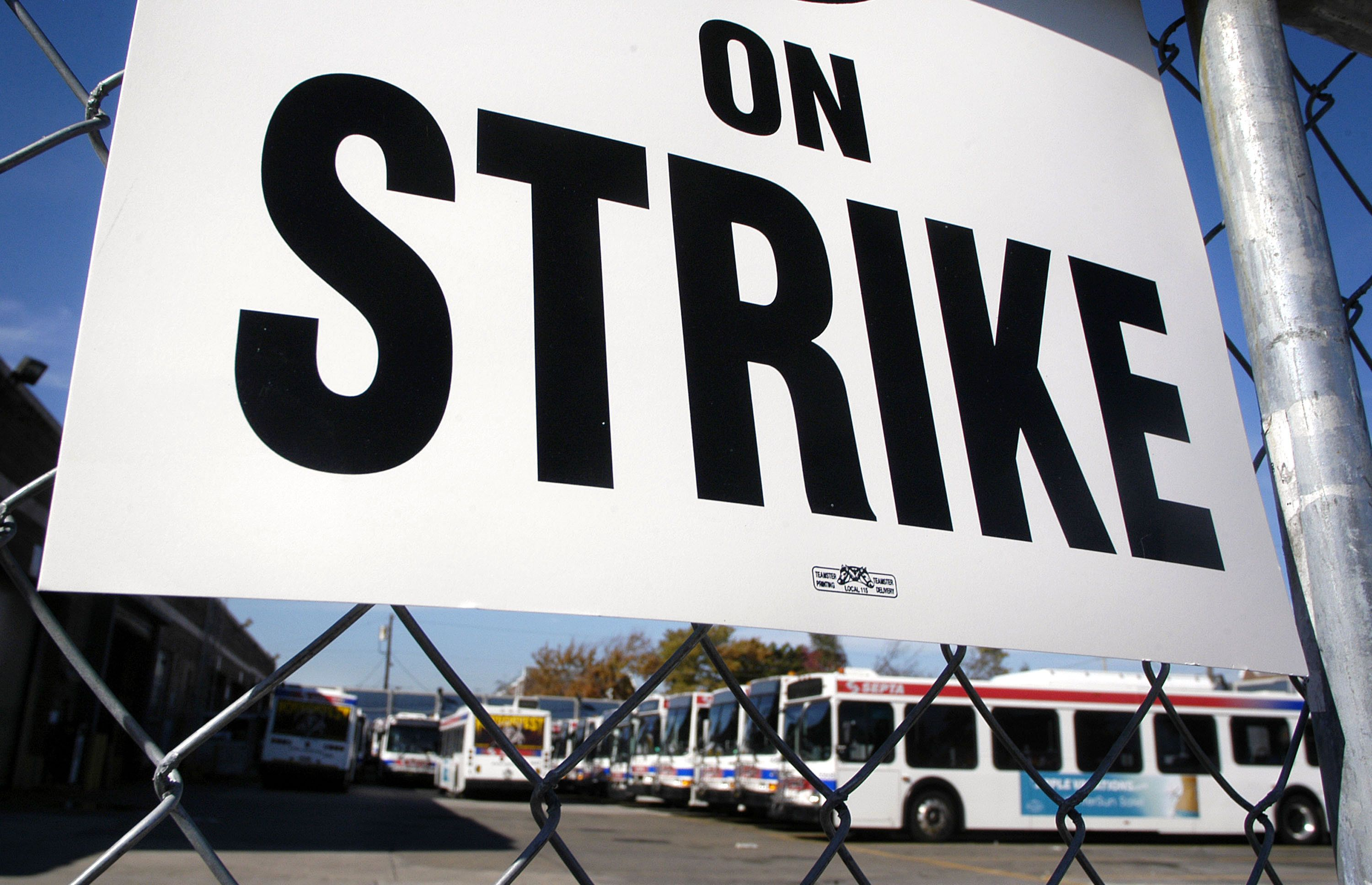 PHILADELPHIA - OCTOBER 31:  An 'On Strike' sign rests on a fence at the Comly Street Southeastern Pennsylvania Transportation Authority (SEPTA) Depot as members of Transport Workers Union Local 234 and United Transportation Union Local 1594 picket during a strike at SEPTA's Frankford Transportation Center October 31, 2005 in Philadelphia, Pennsylvania. Much of the Philadelphia region's mass transit system is shut down leaving some 400,000 subway, bus, and trolley riders without transportation. One of the major stumbling blocks in negotiations is SEPTA wants unionized workers to pay for a portion of their healthcare benefits. No new negotiation sessions are scheduled.  (Photo by William Thomas Cain/Getty Images)