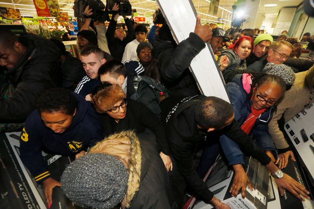 Shoppers fight over deals at an Asda store in 2014. The retail giant pulled out of Black Friday last