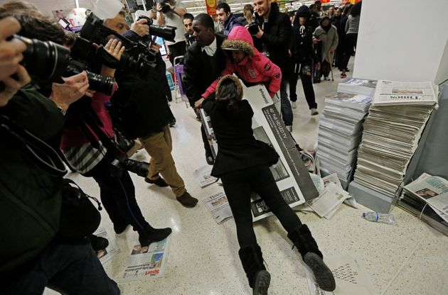 Frenzied scenes as shoppers fight over deals on Black Friday