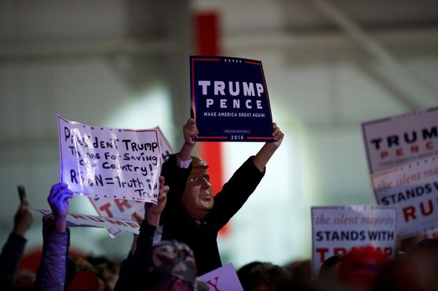 Supporters cheer for Republican presidential nominee Donald Trump during a rally at Atlantic Aviation...