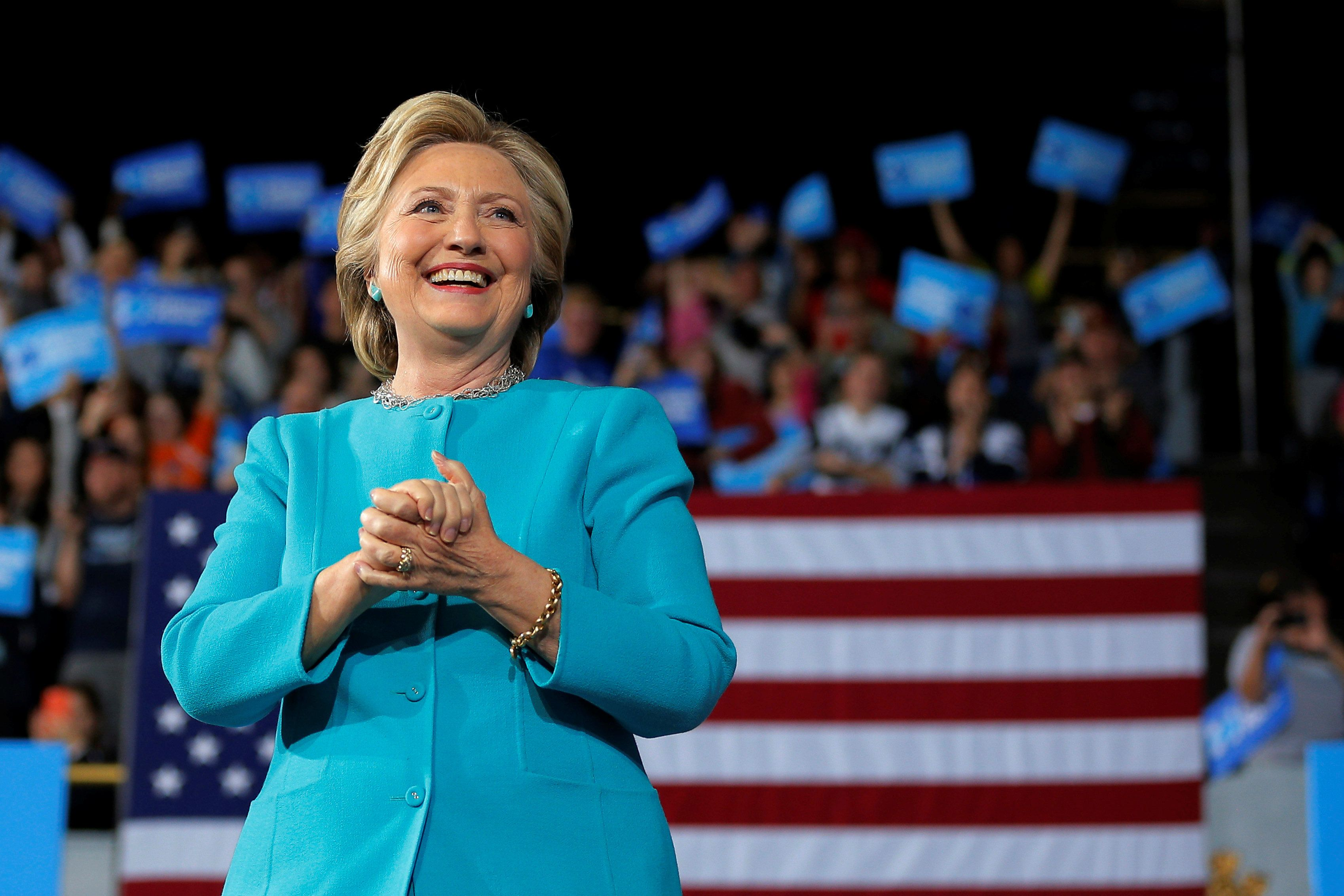 U.S. Democratic presidential nominee Hillary Clinton takes the stage at a campaign rally in Cleveland, Ohio, U.S. November 6, 2016.  REUTERS/Brian Snyder