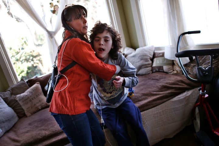 Missy Miller holds her epileptic son Oliver in their home at Atlantic Beach, New York, on Jan. 7, 2014. Oliver suffered a bra