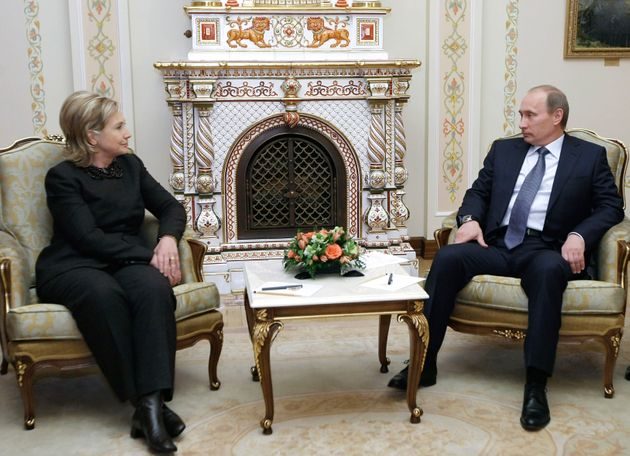 U.S. Secretary of State Hilary Clinton and Russian Prime Minister Vladimir Putin meet at the presidential...