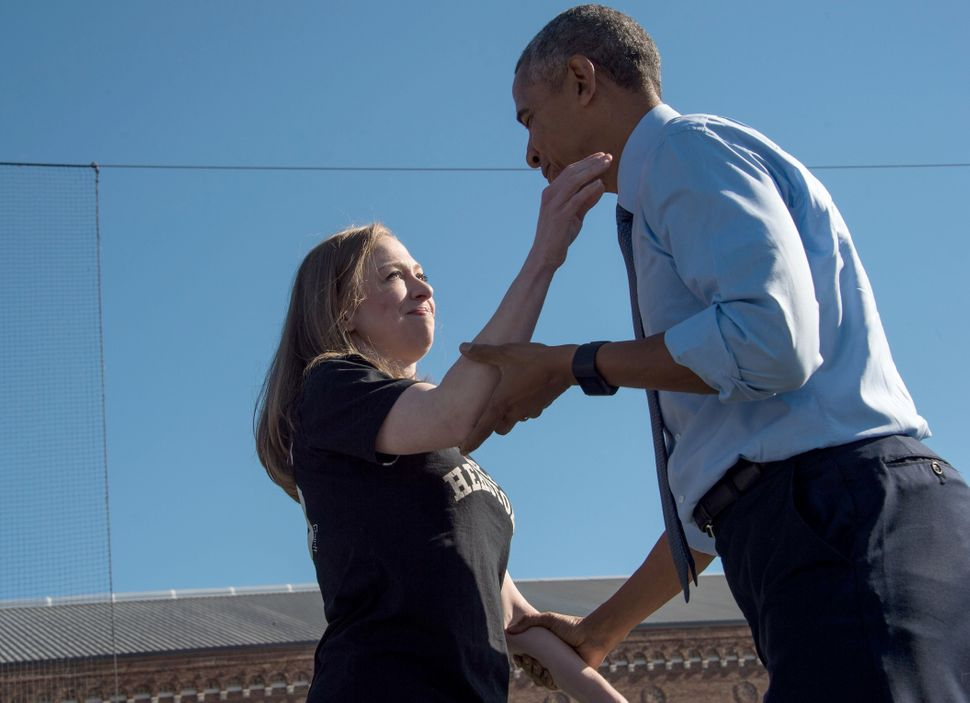 Obama greets Chelsea Clinton after she introduced him at a rally for her mother in Ann Arbor, Michigan.