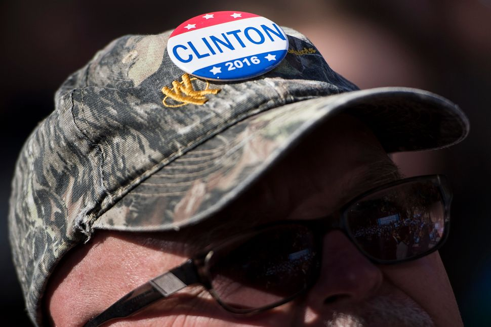 A man listens as Clinton speaks during a rally outside the University of Pittsburgh's Cathedral of Learning in Pittsburgh, Pe