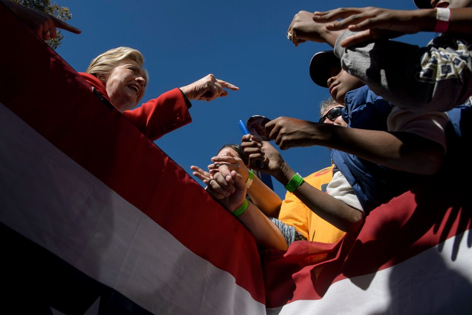 Clinton greets supporters during a rally outside the University of Pittsburgh's Cathedral of Learning in Pittsburgh, Pennsylv