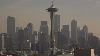 SEATTLE, WA - 2009:  The Seattle Space Needle is seen with a hazy skyline in the background in this 2009 Seattle, Washington, city landscape photo. (Photo by George Rose/Getty Images)