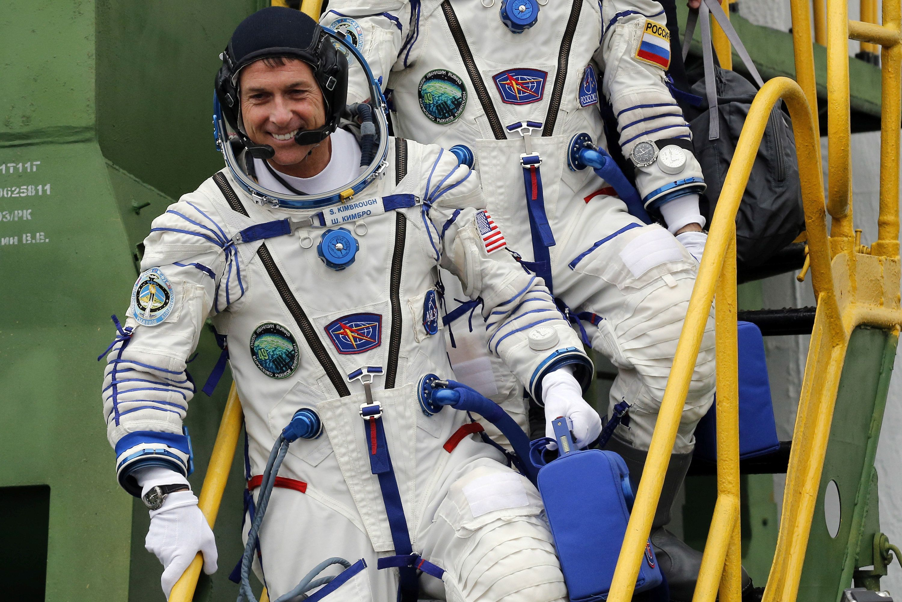 International Space Station crew member Shane Kimbrough, pictured, voted mid-orbit last